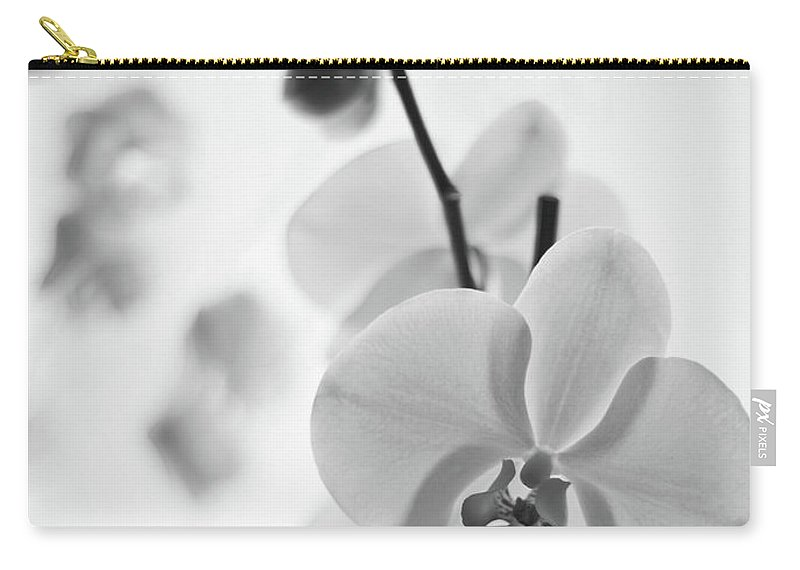 White Carry-all Pouch featuring the photograph White Orchid On White Bw by Alex Art and Photo