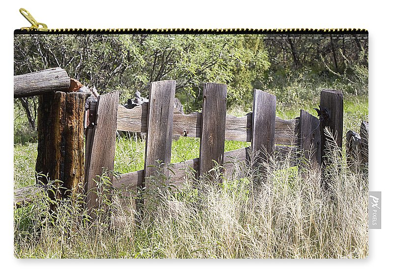 Fence Carry-all Pouch featuring the photograph Who Ate The Fence by Phyllis Denton