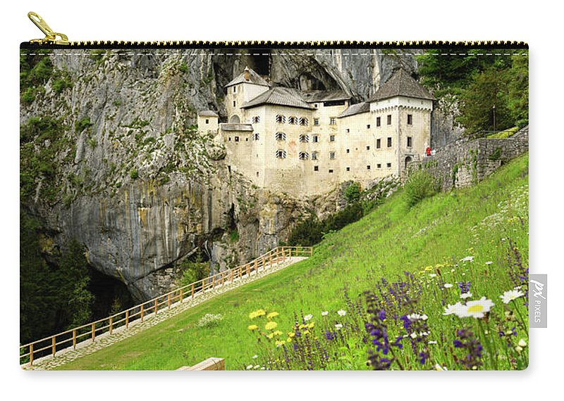 Predjama Castle Carry-all Pouch featuring the photograph Wildflowers On Hillside At Predjama Castle 1570 Renaissance Fort by Reimar Gaertner