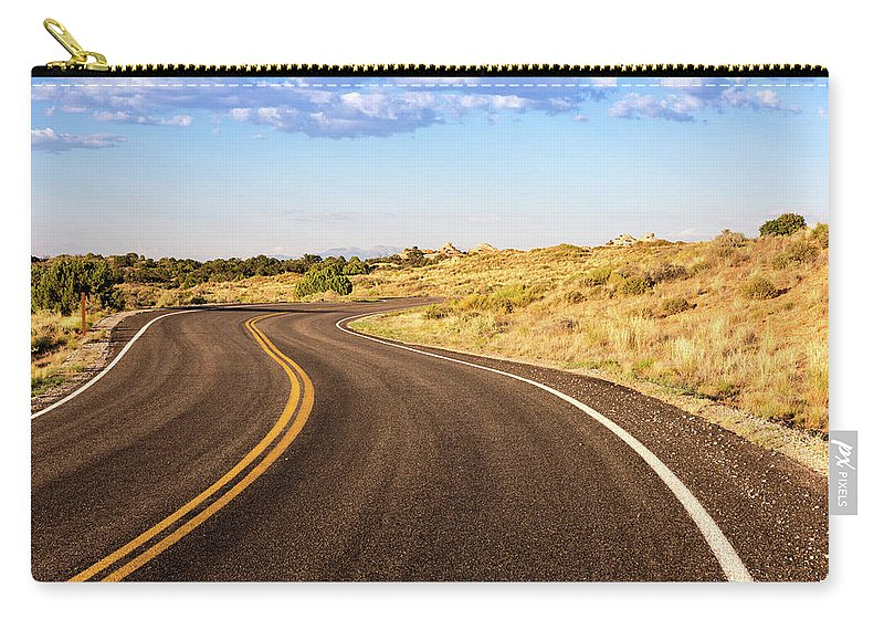 Nature Carry-all Pouch featuring the photograph Winding Desert Road At Sunset by Kyle Lee