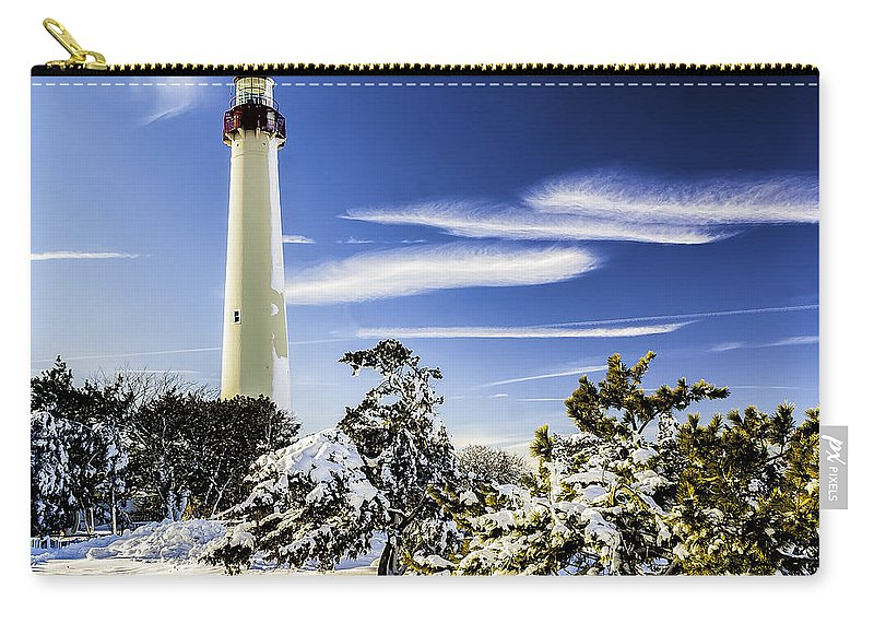 Beacon Carry-all Pouch featuring the photograph Winter At Cape May Light by Nick Zelinsky