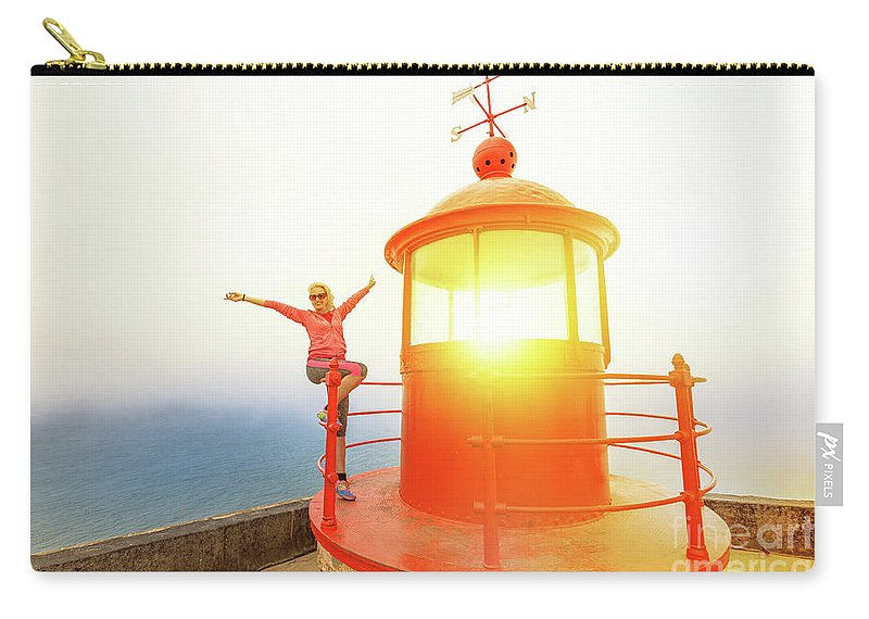 Nazare Portugal Carry-all Pouch featuring the photograph Woman At Nazare Lighthouse by Benny Marty