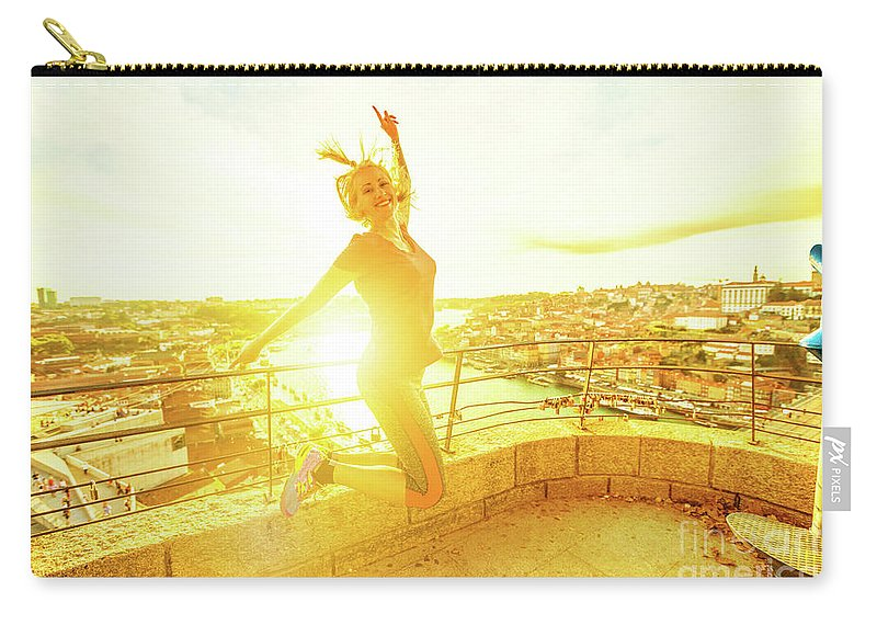 Oporto Carry-all Pouch featuring the photograph Woman Jumping At Oporto by Benny Marty