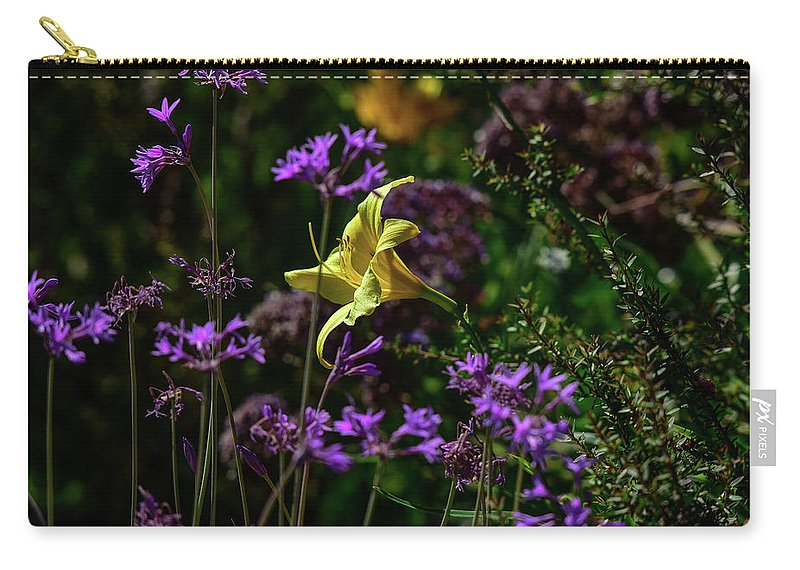 Linda Brody Carry-all Pouch featuring the photograph Yellow Lily Amongst Purple I by Linda Brody