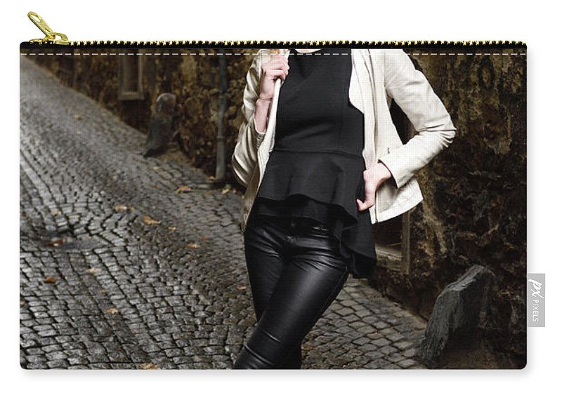 Young Carry-all Pouch featuring the photograph Young Attractive Woman Standing In The Wet Cobblestone Reber All by Reimar Gaertner