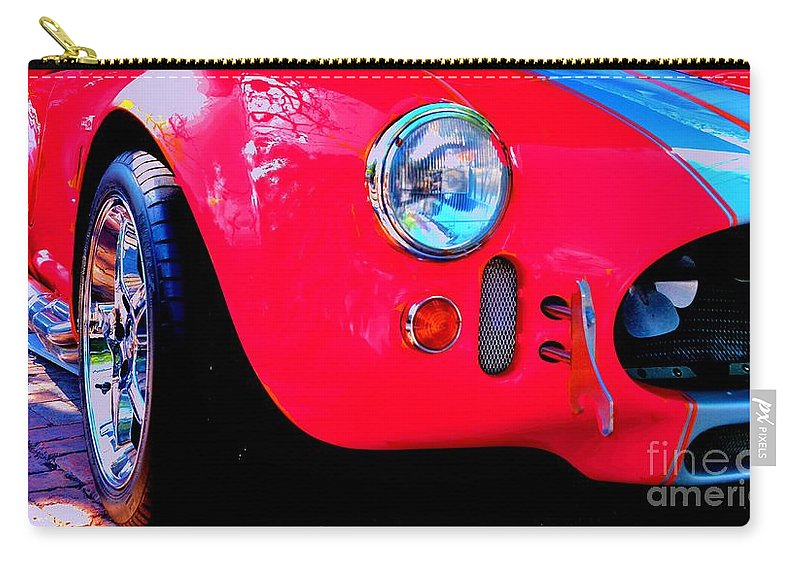Red Carry-all Pouch featuring the photograph Zoom'n by Lisa Renee Ludlum