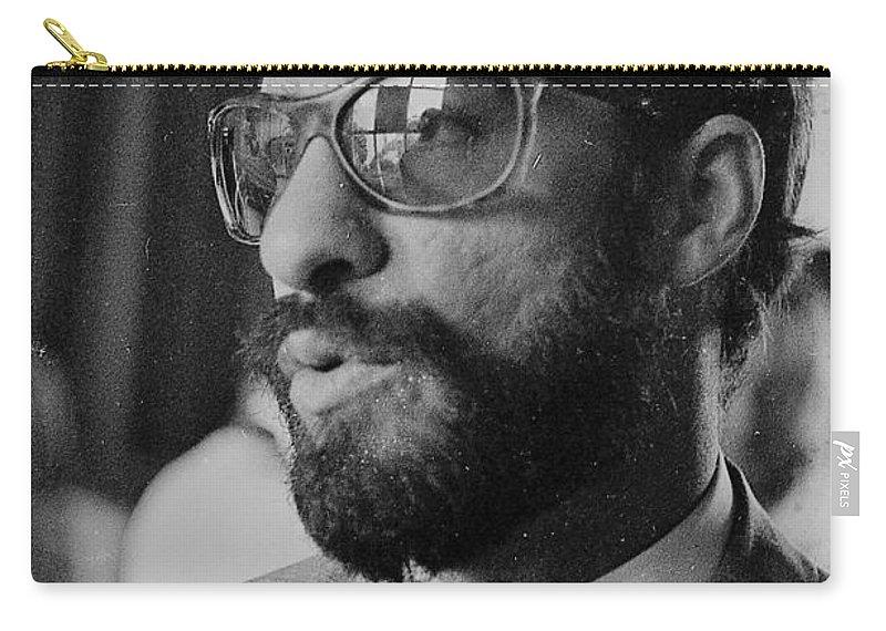 A Cuban Man Carry-all Pouch featuring the photograph a Cuban man by Venancio Diaz