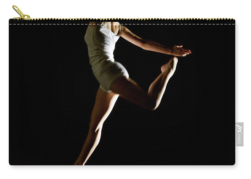 Ballet Dancer Carry-all Pouch featuring the photograph Ballet And Contemporary Dancers by John Rensten