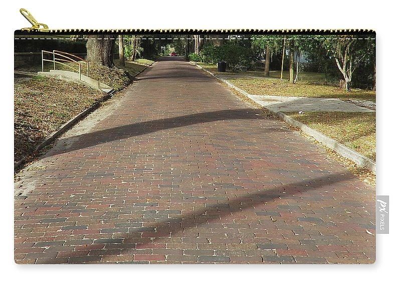 Brick Carry-all Pouch featuring the photograph Brick Road In Palatka Florida by Roger Epps