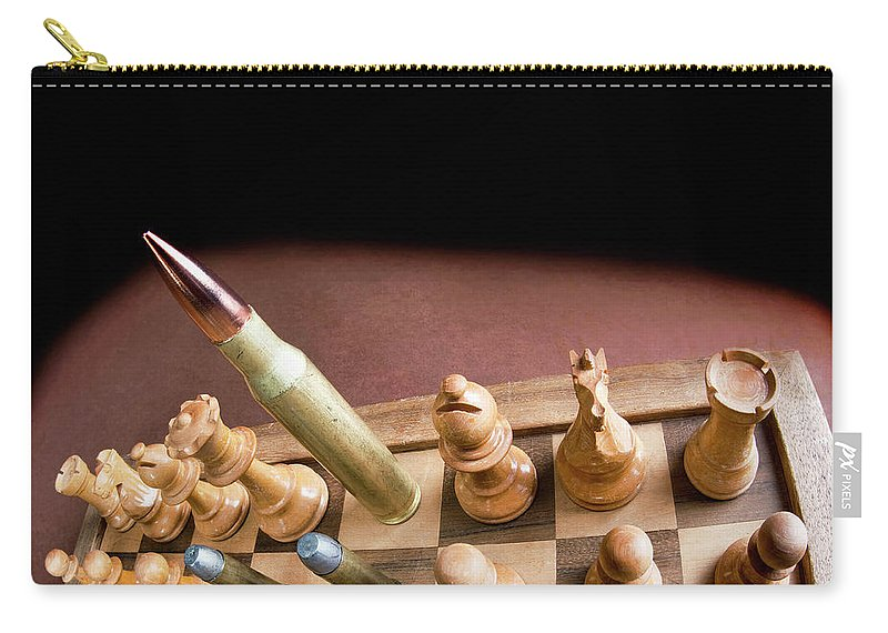 Chess Carry-all Pouch featuring the photograph Chess Board And Bullets. by W Scott McGill