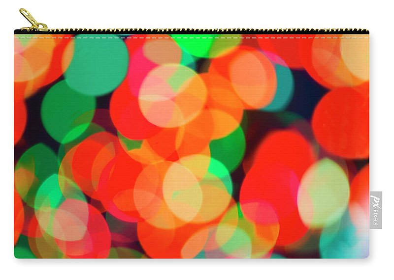Holiday Carry-all Pouch featuring the photograph Defocused Lights by Tetra Images