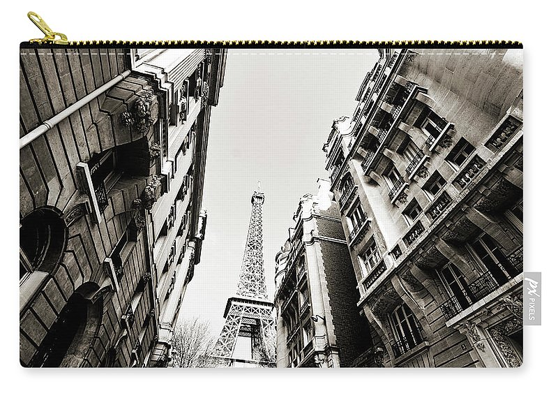 Built Structure Carry-all Pouch featuring the photograph Eiffel Tower Between Buildings In by Flory