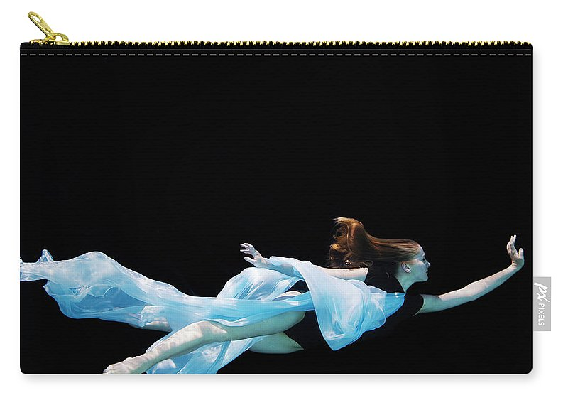Ballet Dancer Carry-all Pouch featuring the photograph Female Dancer Underwater Against Black by Thomas Barwick