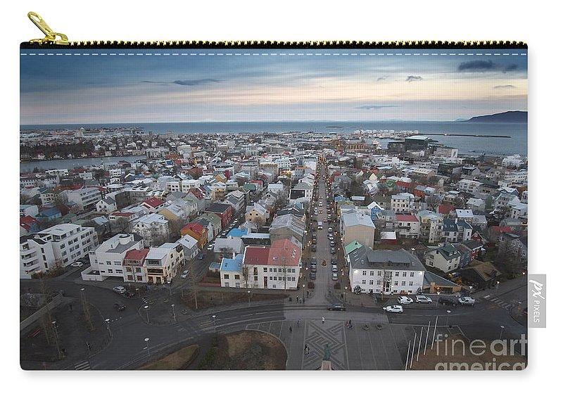 Hallgrimskirkja Carry-all Pouch featuring the photograph Hallgrimskirkja by Floyd Menezes