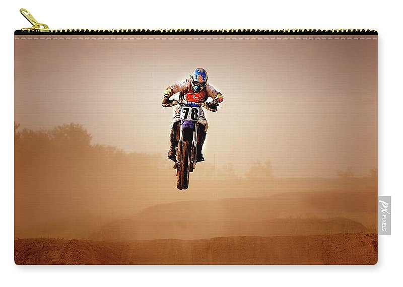 Crash Helmet Carry-all Pouch featuring the photograph Motocross Rider by Design Pics