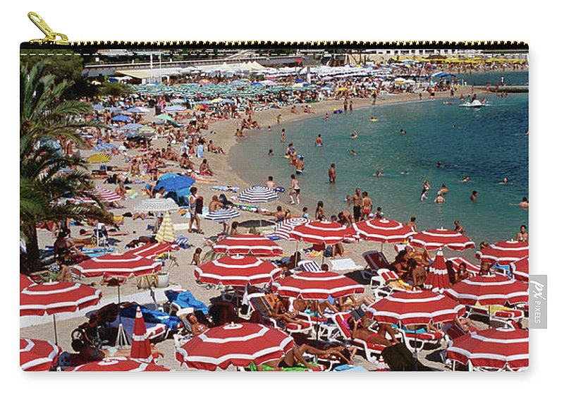 Shadow Carry-all Pouch featuring the photograph Overhead Of Red Sun Umbrellas At by Dallas Stribley