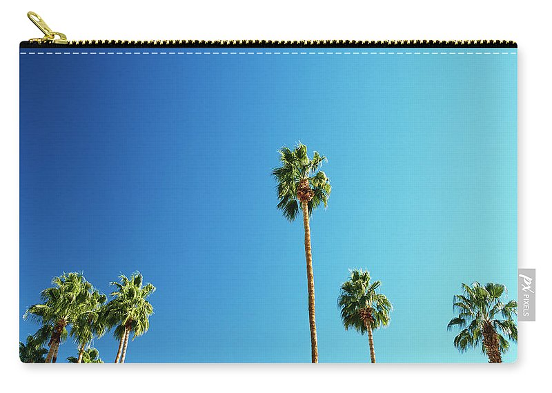 Clear Sky Carry-all Pouch featuring the photograph Palm Trees Against Blue Sky by Micha Pawlitzki