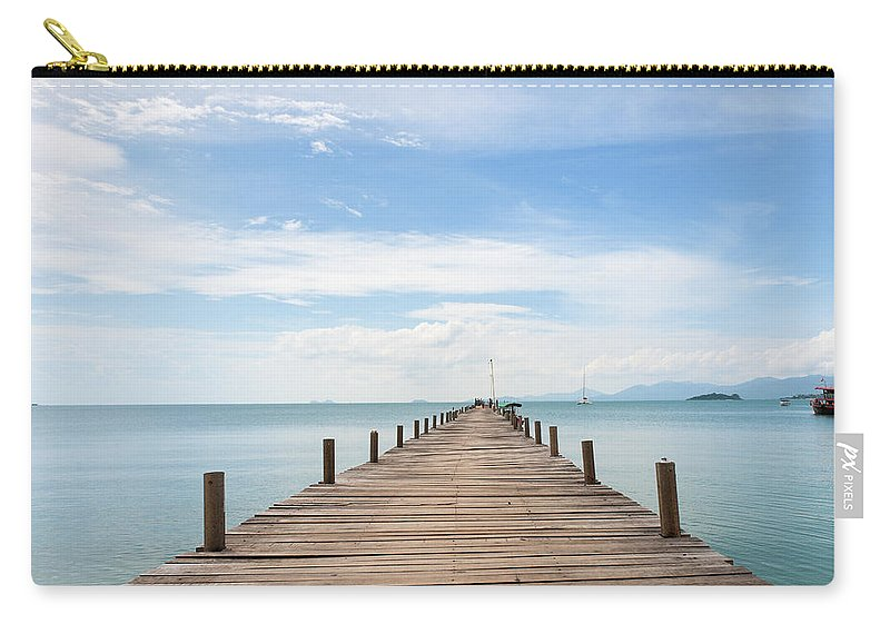 Scenics Carry-all Pouch featuring the photograph Pier On Koh Samui Island In Thailand by Pidjoe