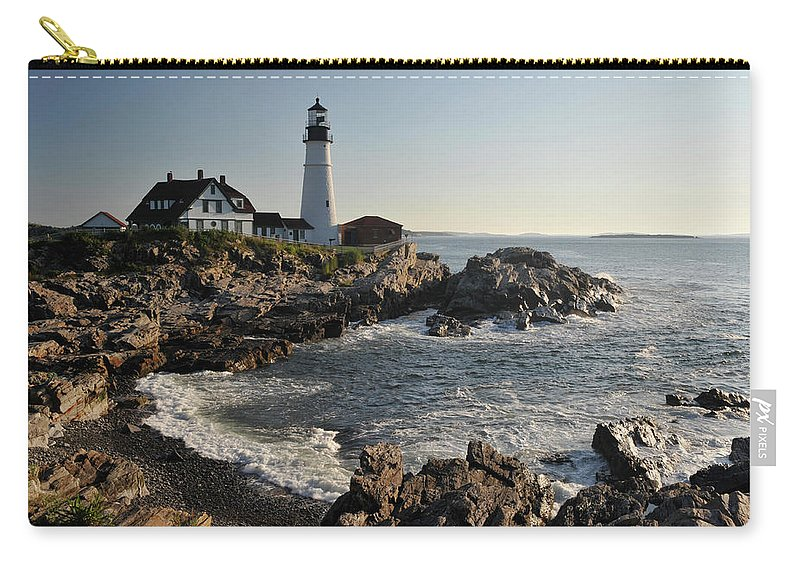 Water's Edge Carry-all Pouch featuring the photograph Portland Head Light by Aimintang