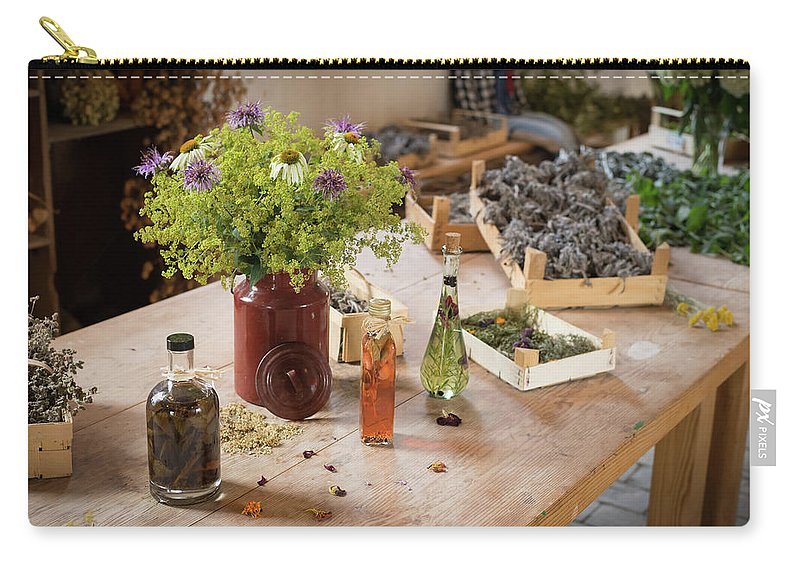 Nature Carry-all Pouch featuring the photograph Rustic Wooden Table With Various Herbs And Flowers by Stefan Rotter
