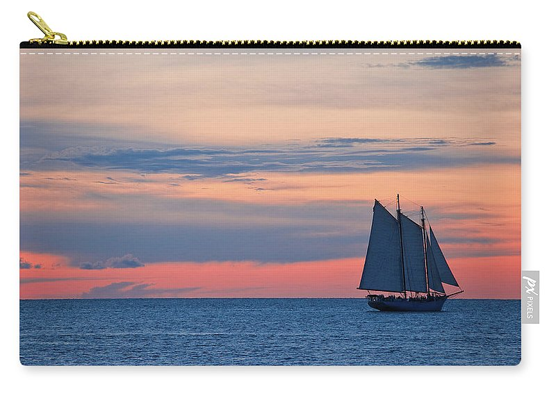 Sailboat Carry-all Pouch featuring the photograph Sailboat At Sunset by Thepalmer