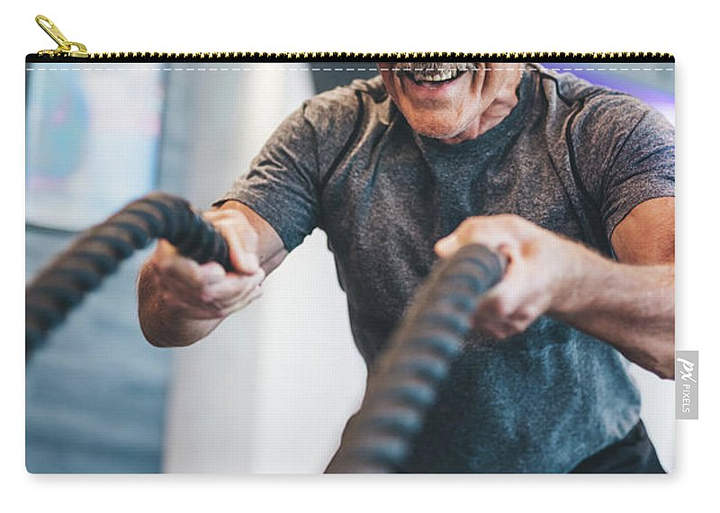 Man Carry-all Pouch featuring the photograph Senior Man Exercising With Ropes At The Gym. by Michal Bednarek