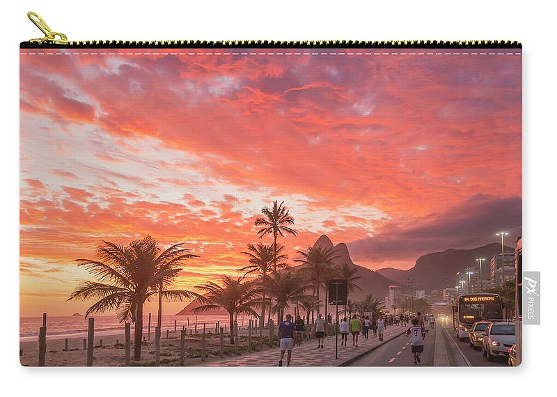 Majestic Carry-all Pouch featuring the photograph Sunset Over Ipanema Beach by Buena Vista Images