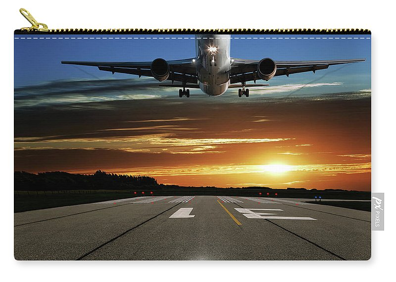 Orange Color Carry-all Pouch featuring the photograph Xl Jet Airplane Landing At Sunset by Sharply done