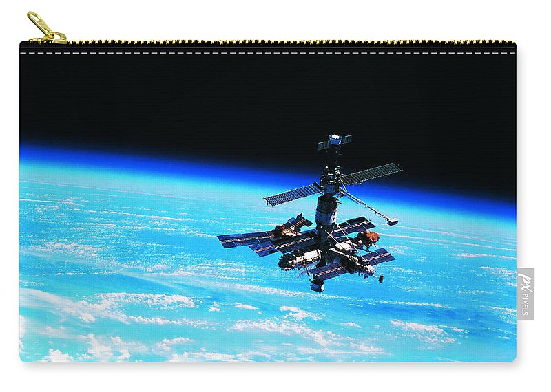 Alertness Carry-all Pouch featuring the photograph A Space Station Orbiting Above Earth by Stockbyte