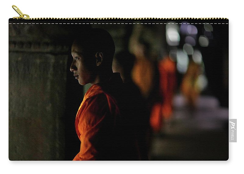 People Carry-all Pouch featuring the photograph Buddhist Monks At Angkor Wat Temple by Timothy Allen