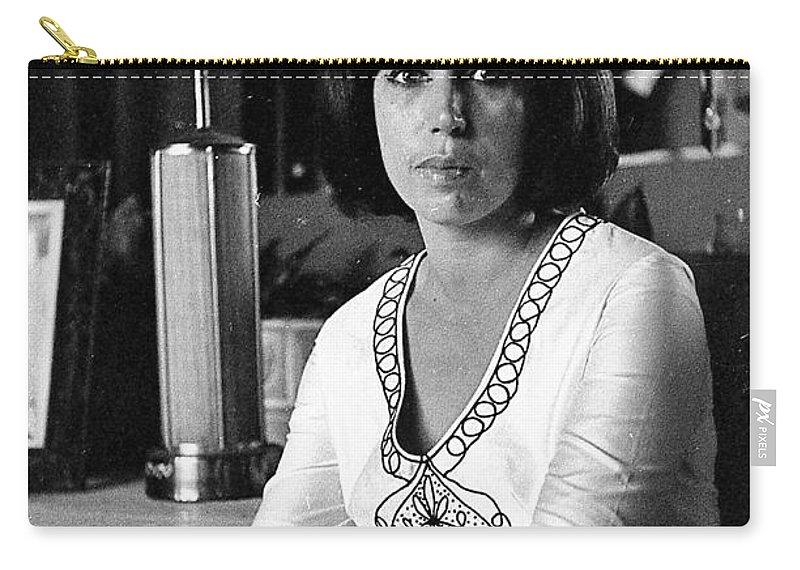 A Cuban Woman Carry-all Pouch featuring the photograph a Cuban woman by Venancio Diaz