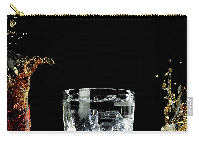 Alcohol Carry-all Pouch featuring the photograph Splashed Cocktails by Monica Rodriguez