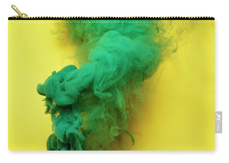 Motion Carry-all Pouch featuring the photograph Colored Smoke by Henrik Sorensen