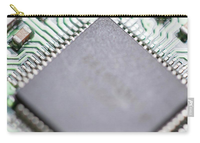 Electrical Component Carry-all Pouch featuring the photograph Close-up Of A Circuit Board by Nicholas Rigg