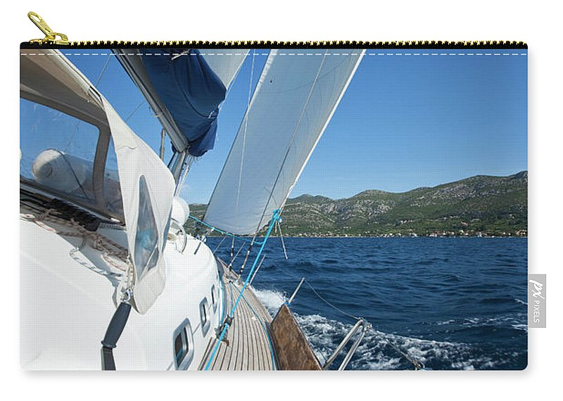 Curve Carry-all Pouch featuring the photograph Sailing In The Wind With Sailboat by Mbbirdy