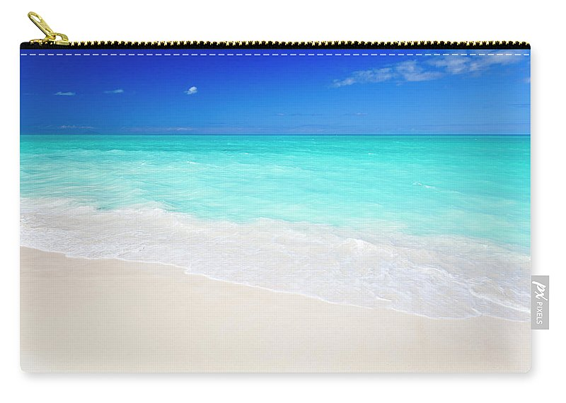 Water's Edge Carry-all Pouch featuring the photograph Clean White Caribbean Beach With Blue by Michaelutech
