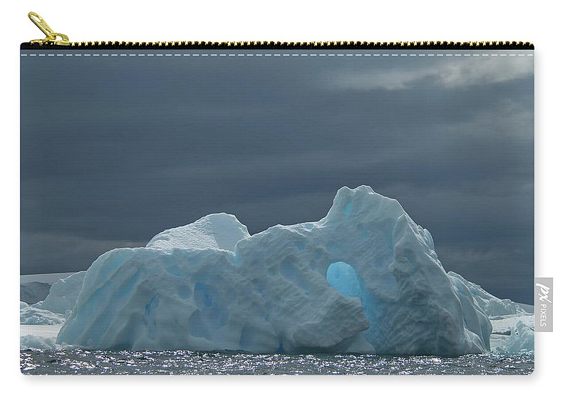Iceberg Carry-all Pouch featuring the photograph Iceberg Along The Antarctic Peninsula by Mint Images - David Schultz