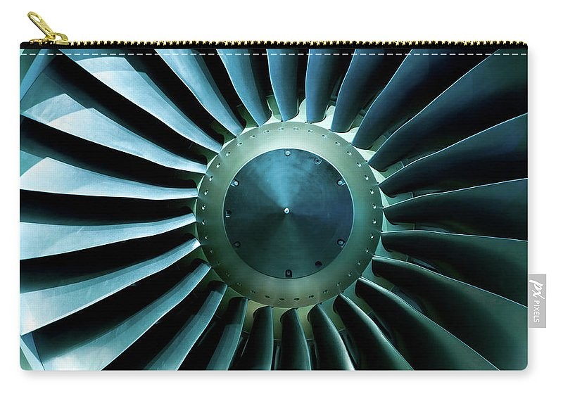 Material Carry-all Pouch featuring the photograph A Close Of Up A Turbine Showing The by Brasil2
