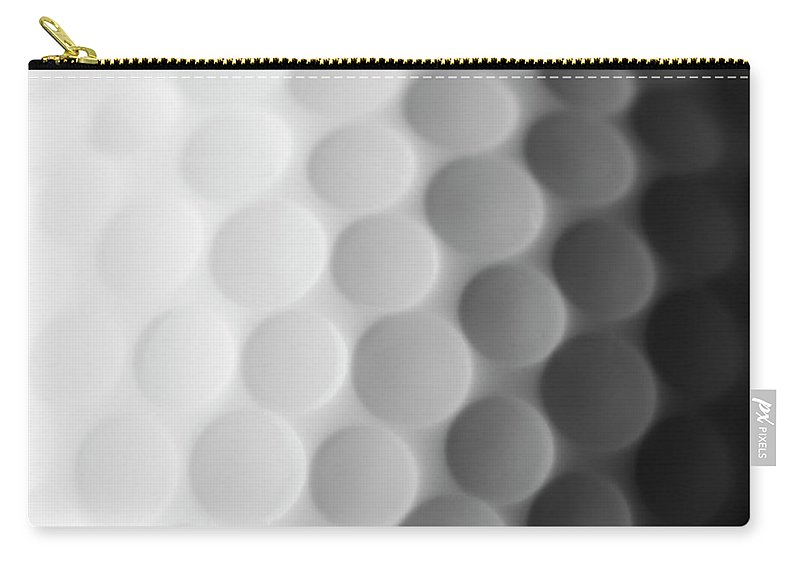 Ball Carry-all Pouch featuring the photograph A Close Up Shot Of A Golf Ball, White by Anthiacumming