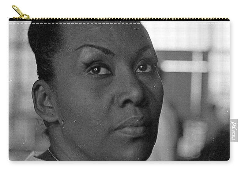 The Cuban Woman Carry-all Pouch featuring the photograph a Cuban woman by Venancio Diaz
