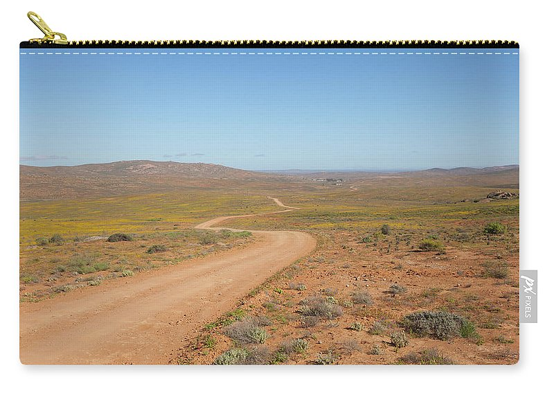 Outdoors Carry-all Pouch featuring the photograph A Dirt Road Winds Through The Barren by Anthony Grote