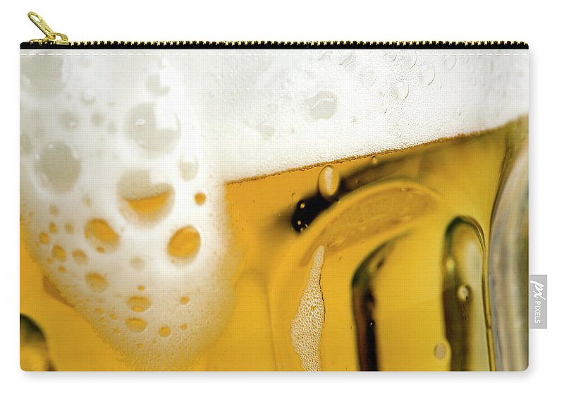 Alcohol Carry-all Pouch featuring the photograph A Glass Of Beer by Caspar Benson