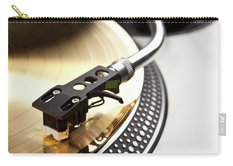 Music Carry-all Pouch featuring the photograph A Gold Record On A Turntable by Caspar Benson