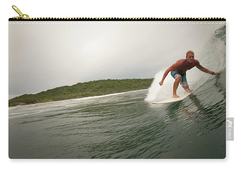 Focus Carry-all Pouch featuring the photograph A Male Surfer In A Barrel Of A Wave In by Sean Murphy