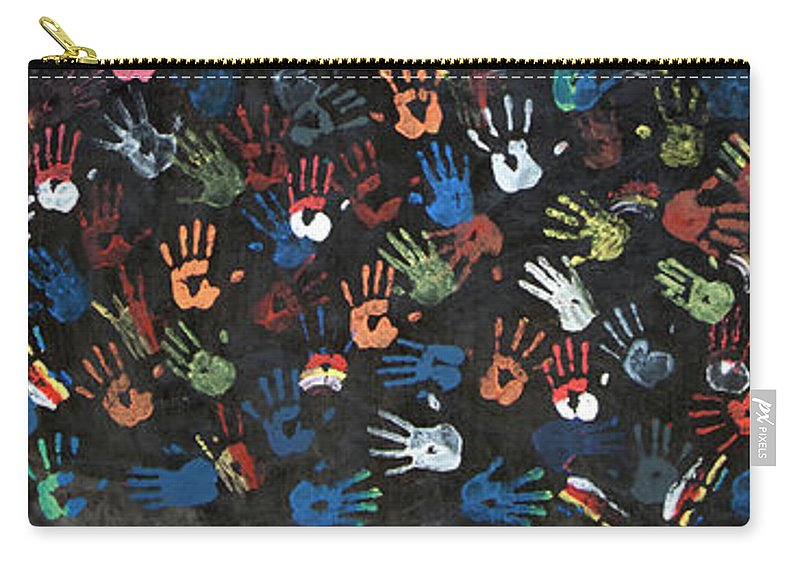 Child Carry-all Pouch featuring the photograph A Painting Of Colorful Handprints by Khananastasia