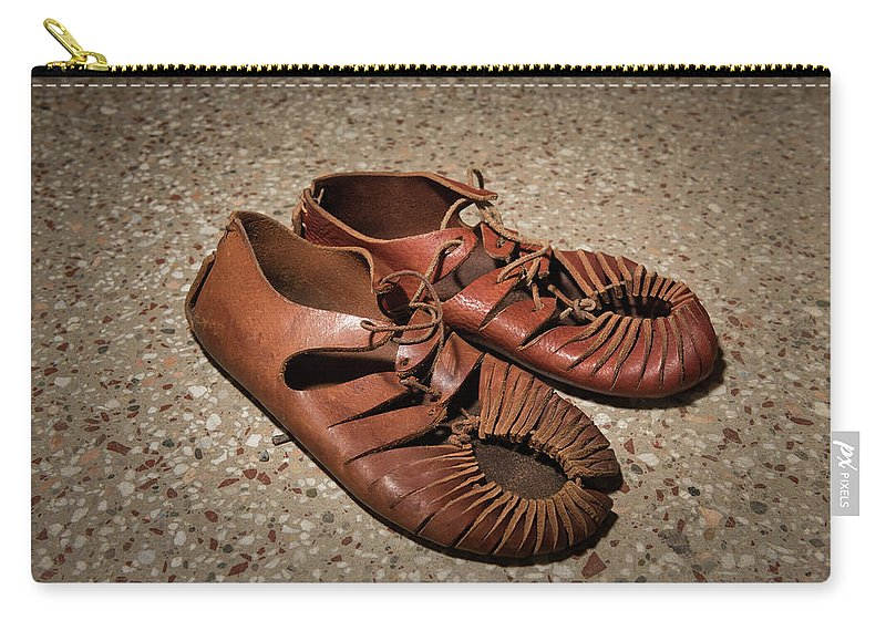 Clothing Carry-all Pouch featuring the photograph A Pair Of Roman Sandals Made Of Leather by Stefan Rotter