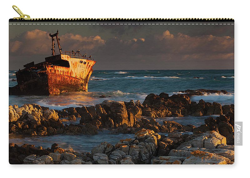 Non-urban Scene Carry-all Pouch featuring the photograph A Rusting Wreck, An Abandoned Ship Off by Mint Images - Art Wolfe