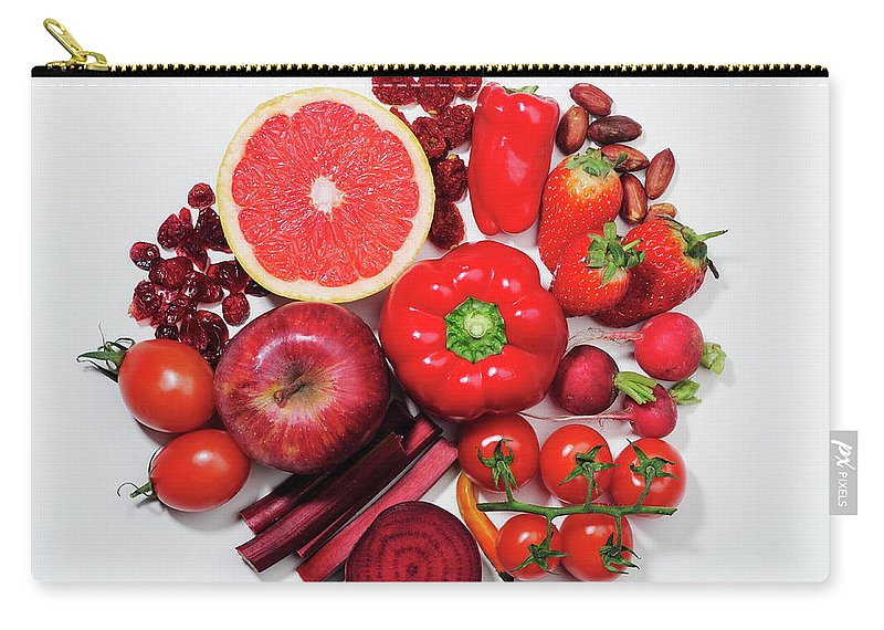 White Background Carry-all Pouch featuring the photograph A Selection Of Red Fruits & Vegetables by David Malan