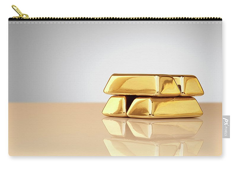 Four Objects Carry-all Pouch featuring the photograph A Stack Of Four Gold Ingots by Anthony Bradshaw