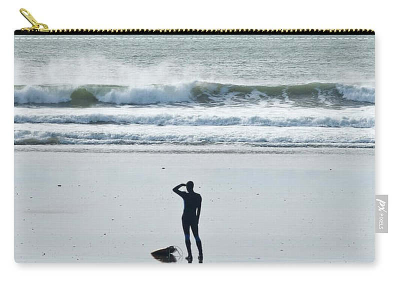 Young Men Carry-all Pouch featuring the photograph A Surfer Watches The Waves Before by Mark Marchesi